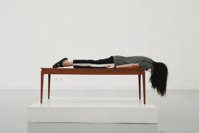 woman lying face down on a table - Why HRT is NOT Enough